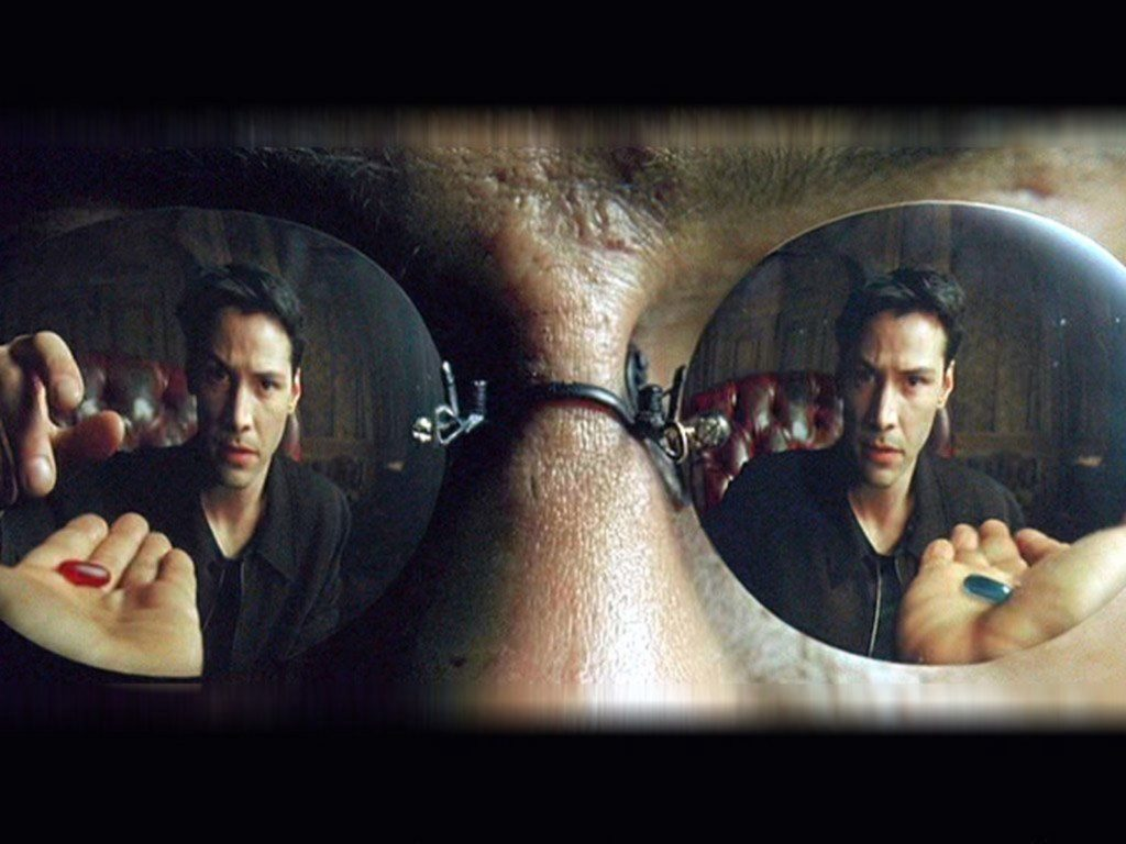 Morpheus offers Neo two pills. The Matrix, 1999.